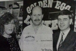 Winner of the Golden Egg Lottery is Tracy Poland who is pictured being presented with her cheque for �1,000 by Pat Bradley (left), lottery promoter and (centre) Eugene Diamond, owner of 'Sweet Sensation' where Tracey bought her winning ticket. 1989.