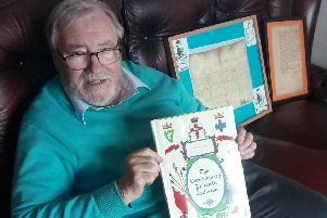 Robert McAuley with his Tercentenary Collection of first day covers which commemorates 14 of King William's battles in Ireland. In the background are two signed letters from King William and the Duke of Leinster, Meinhardt Schomberg