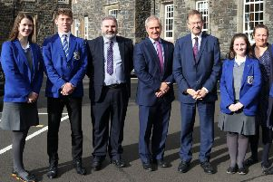 "Principal Jonny Brady, Mrs S Kinney, head of history, parent John Ramsey and students welcomed �amon "" Cu�v TD to St. Killian's College on Thursday."