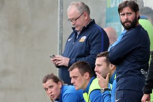 Glenavon manager Gary Hamilton (right) sharing the dugout with part of the backroom team.