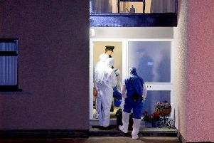 Forensic teams and PSNI officers at the scene of the murder at Devenagh Court, Ballymena