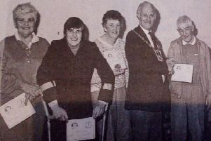 Pupils of the Ballymena Leisure Centre disabled swimming classes pictured with the Mayor, Sandy Spence, who presented them with their swimming awards at a recent ceremony in the town. Included are: Billy Morgan (coach) with Evelyn Vogan,  Elizabeth Close, Hilary McCartney, Alan Craig and Mary McAuley. 1989.