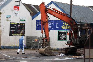A digger, which had been stolen from a nearby site, was used in the raid at the Nisa shop on Brook Street in Ahoghill. Pic: Matt Mackey /   Press Eye