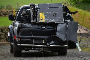 The pick-up vehicle and stolen cash machines were abandoned at Woodside Road. Pic: Colm Lenaghan/Pacemaker