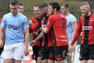 Rory Patterson celebrates scoring for Crusaders against Ballymena United. Pic by INPHO.