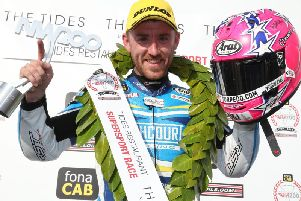 Lee Johnston celebrates his victory in the Supersport race at the North West 200 on Thursday. Picture: Stephen Davison/Pacemaker Press.