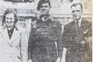Sergeant Peter McCambridge, 7th Parachute Battalion, 6th Airborne Division, with relatives outside Buckingham Palace.