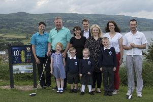 Olderfleet Primary's Parents Association are holding a stableford golf competition at Cairndhu Golf Club on September 1 in aid of school funds. Pictured are: Cairndhu Golf Club Members, P6 teacher Mrs Godfrey, parents from the PTA, pupils of Olderfleet Primary and two sponsors of the event -Kelly Lee Thompson of Inkpots Day Nursery and Matthew Scott of Independent Homes.