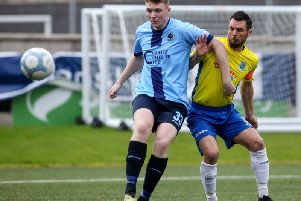 Institute's Aaron McGurk, who scored his first senior goal, shields the ball from Ballymena United skipper Jim Ervin