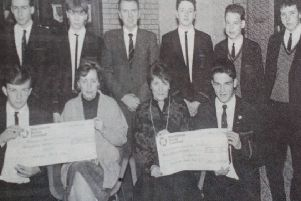 Receiving a cheque for �1,500 from the Cambridge House Boys' School on behalf of NI Hospice are Mrs Agarwala and Mrs Bloomer (seated front).  Presenting the cheque are class representatives and included is principal, WJ Wallace. 1989