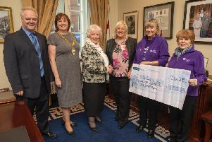 Mrs Joan Christie CVO, OBE pictured with Mayor Maureen Morrow and Heather Weir Chief Executive NI Children's Hospice, David Clements, Chair NI Hospice, Muriel Barr and Toni Bailes, Ballymena NI Hospice support group.