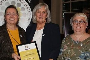 Oonagh Dalton (first left) received her award from Paula Hillman of the Police Service of Northern Ireland, watched on by Coleen Christie of Cullybackey Methodist Church.]