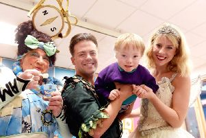 Cooper, 3, from Donaghadee  taking flight with legendary local panto star May McFettridge, Peter Pan (Mikey Jay-Heath) and Tinkerbell (Hollie ODonoghue)