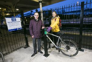 Pictured unveiling the new secure cycle parking compound at Lisburn Train Station are Translink's Gary Dunlop and Claire McLernon from Sustrans.