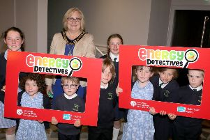 The Mayor of Causeway Coast and Glens Borough Council Councillor Brenda Chivers pictured with pupils from St Mary's Primary School on Rathlin Island at the Energy Detectives celebration event.