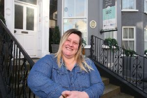 Tamar Brunton, Operations Manager of Portrush Boutique Townhouse Hostel located on Bath Street in Portrush, one of the properties to benefit from the Revitalise scheme funded by the Department for Communities (DfC) and delivered by Causeway Coast and Glens Borough Council.