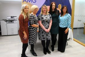 The staff from AMG pictured at the official opening of the new office
