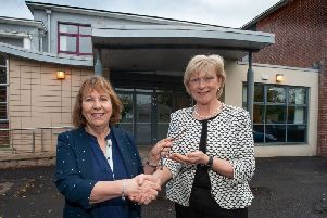 Pictured (L-R); Professor Terri Scott, Principal and Chief Executive of Northern Regional College accepts the keys of St Joseph's College, Coleraine from Mrs Mary Millar, who retired as school principal of the school on August 31. Northern Regional College will relocate to the Beresford Avenue premises while its campus at Union Street is being redeveloped