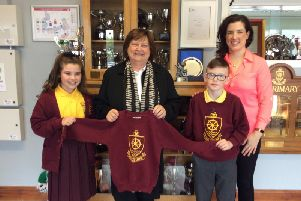 Pictured is Millburn Head Boy and Head Girl handing over school uniforms to Roisin McCaughan (ZAP), with teacher Ms Kathryn Robinson