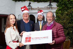 Pictured are (l-r) Zoe Dunlop, Director, Bushmills Inn; Colin Barkley, Chair, Northern Ireland Children to Lapland and Days to Remember Trust (NICTL), Alan Walls, Hotel Manager, Bushmills Inn and Raymond Pollock MBE, Trustee, NICTL.
