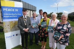 The Mayor of Causeway Coast and Glens Borough Council Councillor Sean Bateson pictured with some of the Clanmil Housing Association participants and Patricia Crossley, Vice Chair of the PEACE IV Partnership at the launch of the 'Lore of the Land' book