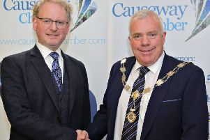 Outgoing President Murray Bell congratulates the new Causeway Chamber of Commerce President David Boyd on his appointment at the AGM held at the Enterprise Causeway offices