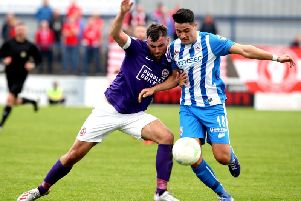 Aaron Traynor tussles with Johnny McMurray