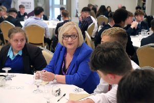Councillor Brenda Chivers pictured with pupils from local secondary schools at the annual 'Let's Talk' event at The Lodge Hotel in Coleraine