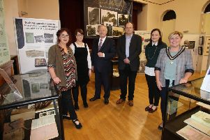The Deputy Mayor of Causeway Coast and Glens Borough Council, Alderman Sharon McKillop pictured with Helen Perry, Museum Services Development Manager, Sarah Carson, Museum Officer, Gordon Craig, Sam Henry's grandson, Dr Frank Ferguson from Ulster University and Rachel Archibald, Project Cataloguer at the launch of the 'Sam Henry: Culture Connects' exhibition at Ballymoney Museum