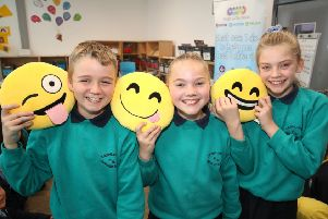 Pictured (l-r) are Graham Glanville, Megan McGarel and Kirsty McCollum from Carnlough Integrated Primary School