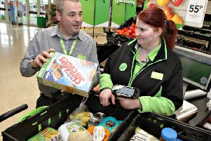 At ASDA Coleraine E-Commerce Supervisor Philip Findlay with Personal Shopper Linda Caldwell scanning the vegetables into the box for the on-line purchases