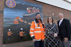 Barry Torrens, Unit Commander of Coleraine Unit, Community Rescue Service (CRS); Leanne Abernethy, IMPACT Project Manager and IFI Board Member, Allen McAdam pictured at the unveiling of a new mural that marks the end of a successful  community based wellbeing initiative around the North Coast
