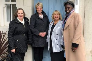 Joy Scott, Group Chair at Clanmil, Carol Mc Taggart, Clanmil Group Director of Development and Siobhan Brown, Clanmil Construction and Defects Manager welcome Karen Mc Laughlin to her new home