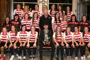 The Mayor of Causeway Coast and Glens Borough Council Councillor Sean Bateson pictured with some of those who attended a recent reception in Cloonavin for members of Ballerin GAA club's Under 16 girls football team and Under 14 and Under 16 camogie teams to mark their recent successes