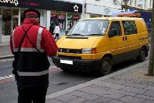 A traffic warden on the look-out for anyone committing parking offences. (Archive pic)