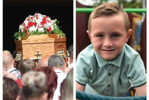 Guard of Honour team mates wipe away tears at eight-year-old Callum's funeral