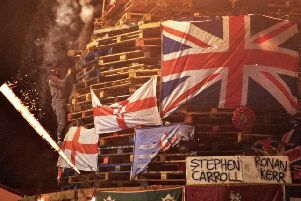 The names of murdered PSNI officers where placed on a controversial bonfire in the Bogside on Wednesday night.