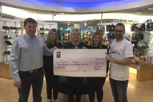 Peter McVeigh (pictured left) of Donaghys, Banbridge presents a cheque for the money raised at the recent Ladies Night held in aid of Ellen's Journey. Attendees were treated to an in-store fashion show with giveaways and raffle prizes on the night, as well as Donaghys store and online discount. Also pictured are Beth McDaniel (Sales Assistant) Sheila Barry (General Manager) Chloe Gibson (Sales Assistant) and Paddy Treanor (Ellen's Father).