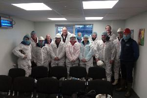 Group members, with protective clothing, prior to the visit with Senan White (back right) and Keith Williamson (front right).