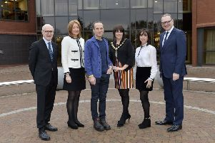 Pictured at Armagh City, Banbridge and Craigavon Borough Council's major 'Transforming Towns Together' conference are (from left) facilitator Jamie Delargy, Director of Retail at Lambert Smith Hampton Criona Collins, renowned award-winning architect, broadcaster and academic Piers Taylor, Lord Mayor Councillor Julie Flaherty, DIGG Childrenswear business owner Caroline O'Neill and Council Chief Executive Roger Wilson.