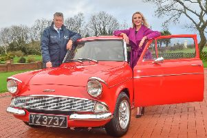 Gearing up for the show with a classic Ford Anglia are Martin Cromwell and Meaghan Green from the shows organising committee.