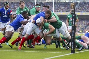 Ireland captain Rory Best drives for the line to score the opening try against France