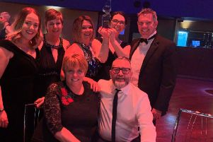 The local Strictly Come Dancing team pictured with their award at the charity event