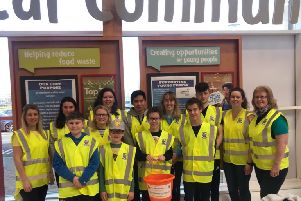 Friends of New-Bridge pictured with the SEN department in New-Bridge Integrated College at a recent bag pack in Tesco