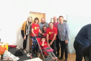 DUP MLA Carla Lockhart pictured with colleagues and the McKee family following a successful coffee morning