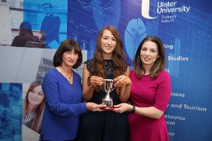 Nadine Moore presented with the PwC Research Methods Award by Course Director, Helen McGuffin (left) and Deborah Stevenson from sponsors PwC (right)