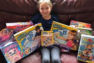 Sarah with her prizes