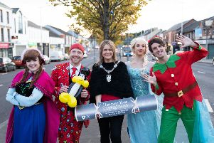 Lord Mayor Mealla Campbell is pictured in Banbridge town centre with some of the performers appearing at this year's Twilight Market and Christmas Lights Switch-On event on Friday, November 29