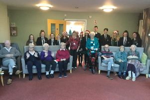 New-Bridge Chamber Choir pictured with the residents of Spelga Mews