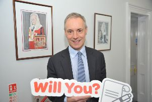 David Bell LLB of Gordon Bell & Son Solicitors showing support for the Northern Ireland Chest Heart and Stroke 'Will You?' initiative
